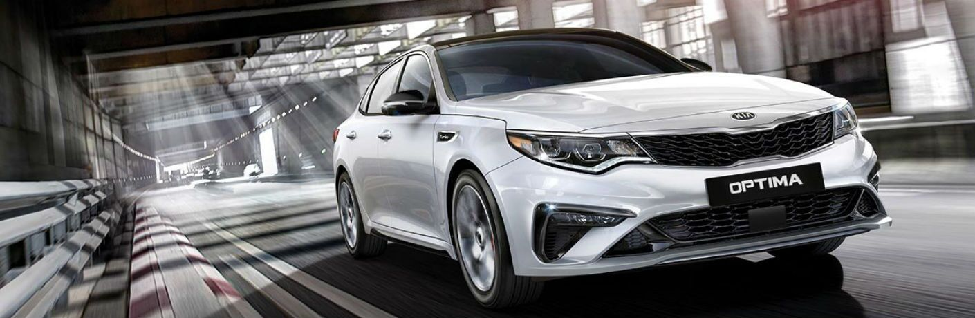 2019 Kia Optima in white speeding down tunnel