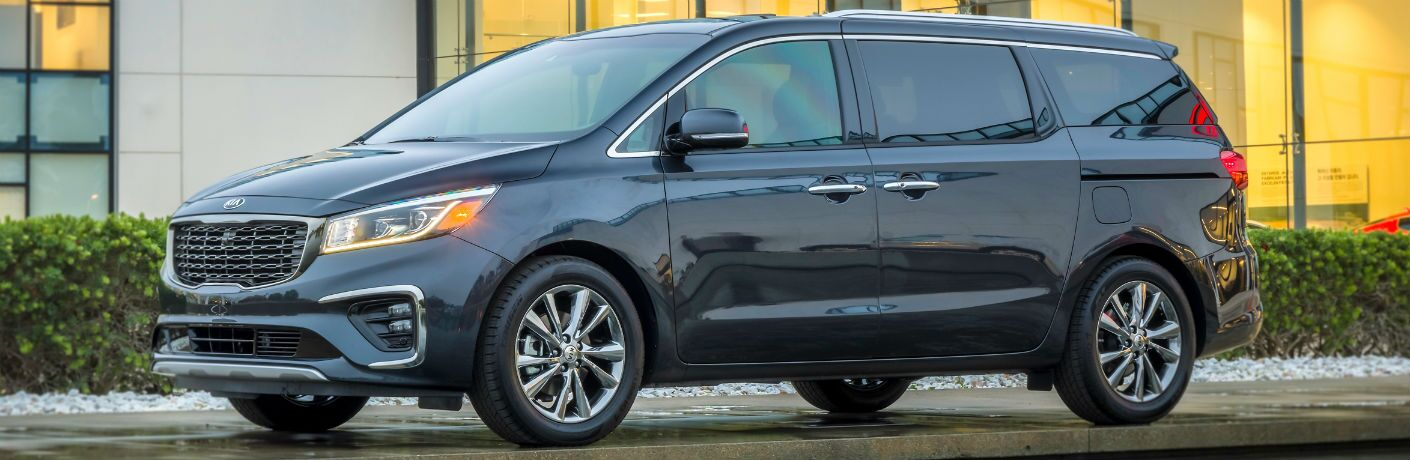 2019 Kia Sedona parked outside of big home