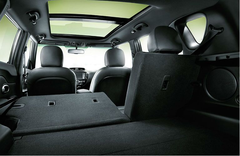 storage space shown through open rear hatch with 60/40 seats folding down in 2019 kia soul