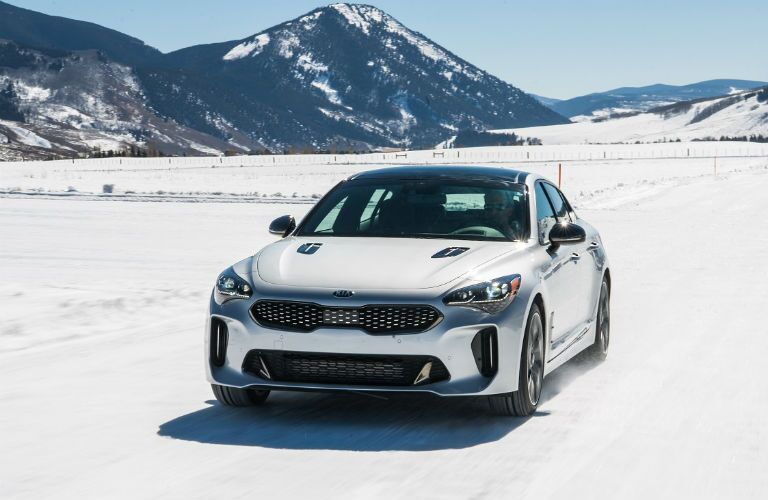 white 2019 kia stinger gt on the snow