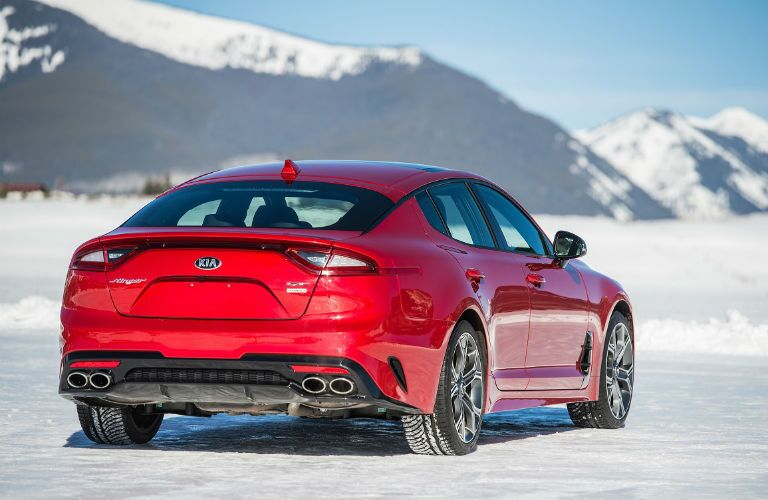 rear of red 2019 kia stinger gt on the snow