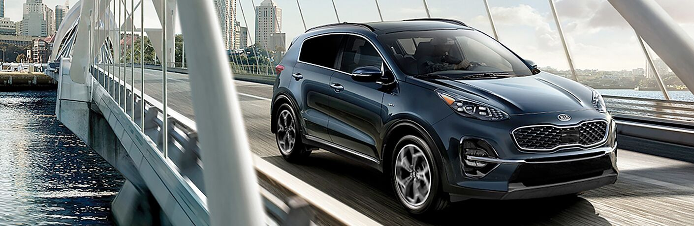 blue 2020 kia sportage driving on bridge near tampa