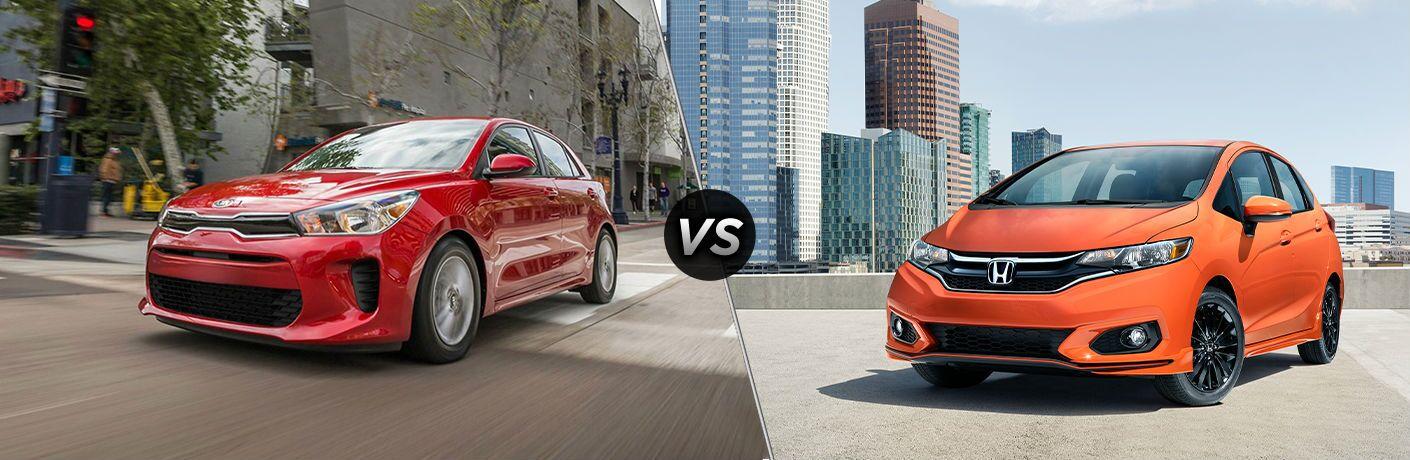 Red 2020 Kia Rio 5-Door and orange 2020 Honda Fit