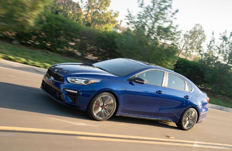 2020 kia forte gt driving in blue