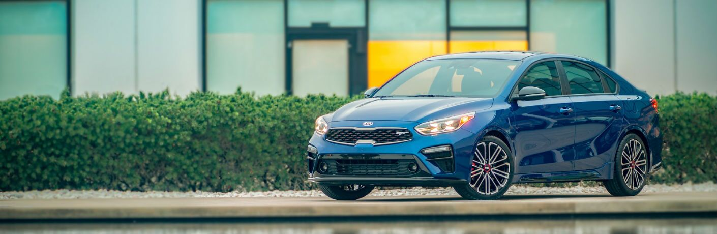 blue 2020 kia forte gt parked and photographed at three quarter angle