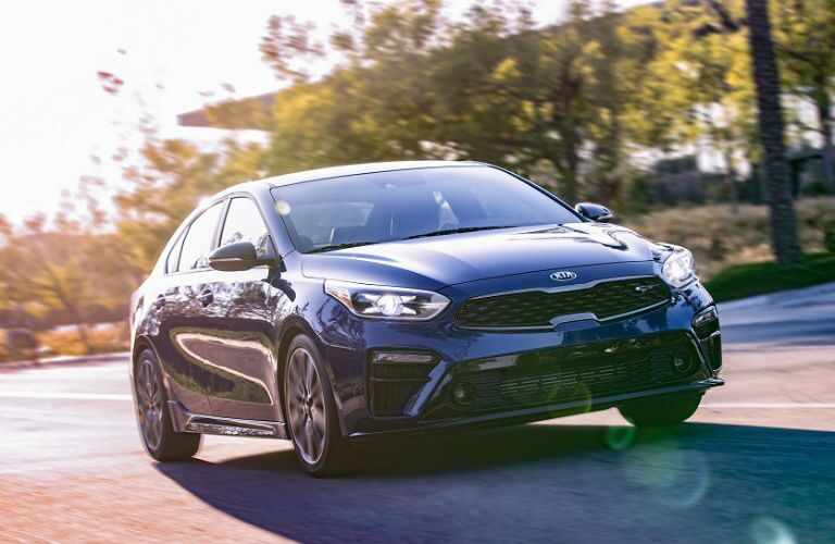2020 kia forte gt in blue driving