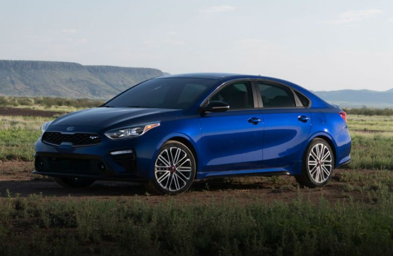 dark blue 2020 kia forte gt on grass