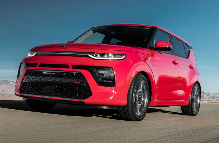 red 2020 kia soul gt line driving on track
