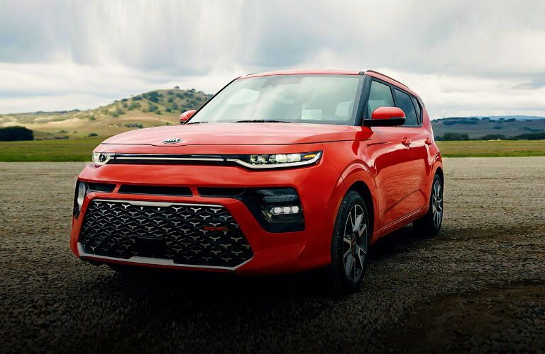 red 2020 kia soul gt on the track
