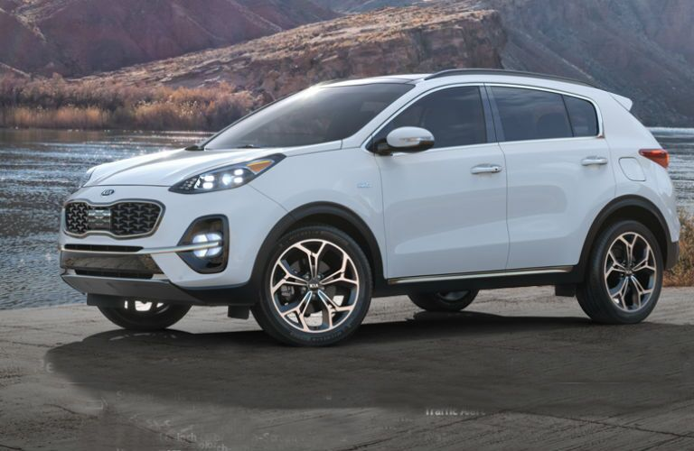 white 2019 kia sportage on the beach