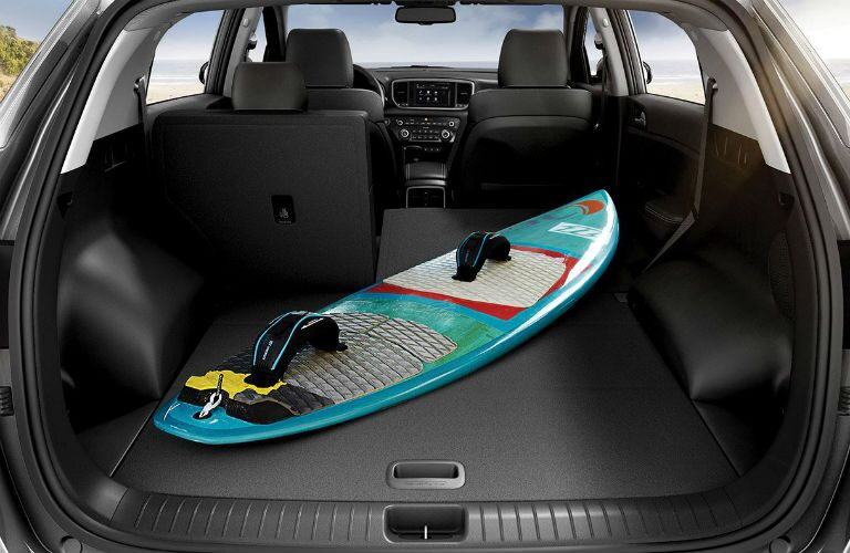 surfboard in back of 2020 kia sportage