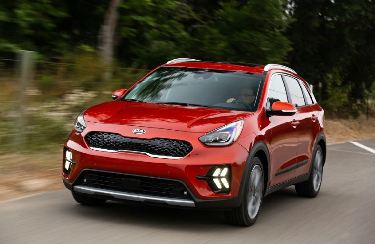 front view of 2020 Kia Niro driving in woods