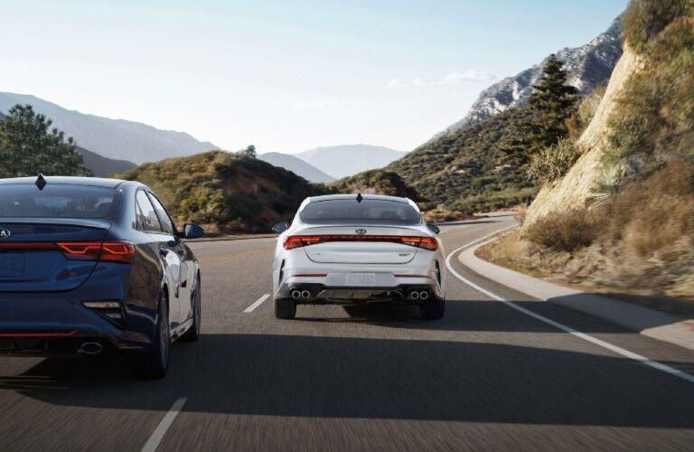Rear view of white and blue 2021 Kia K5 models