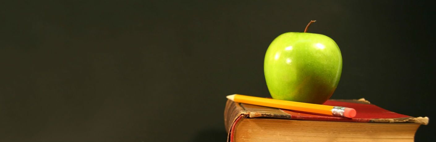 apple and pencil on schoolbooks for back to school