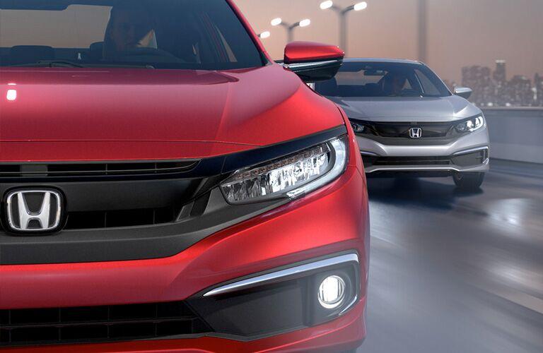 2019 Honda Civic Coupe close up with 2019 Honda Civic Sedan behind it