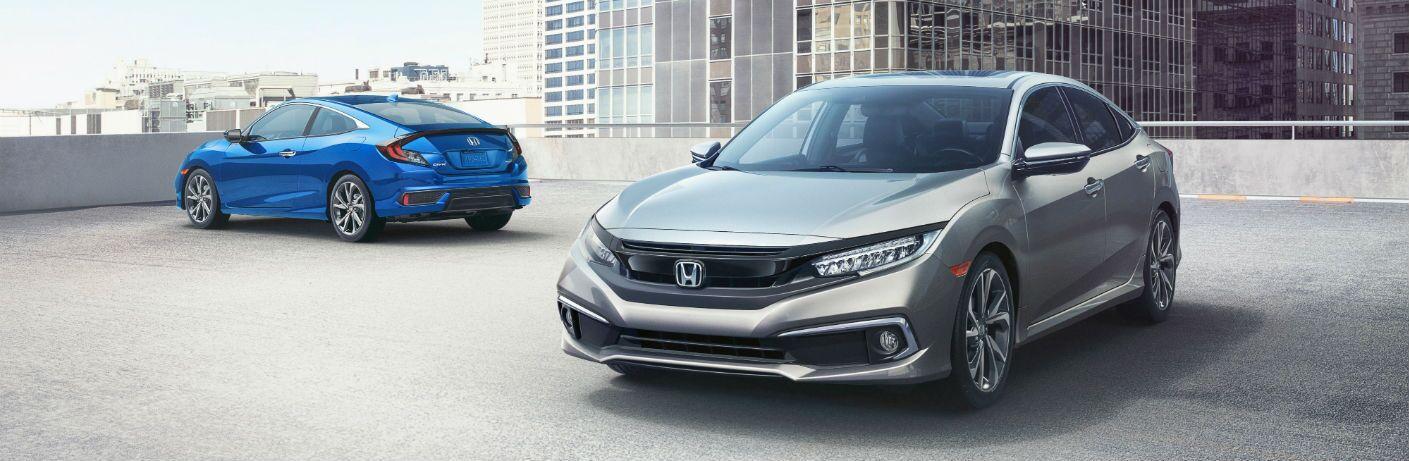 2019 Honda Civic Sedan and 2019 Honda Civic Coupe on a parking garage roof