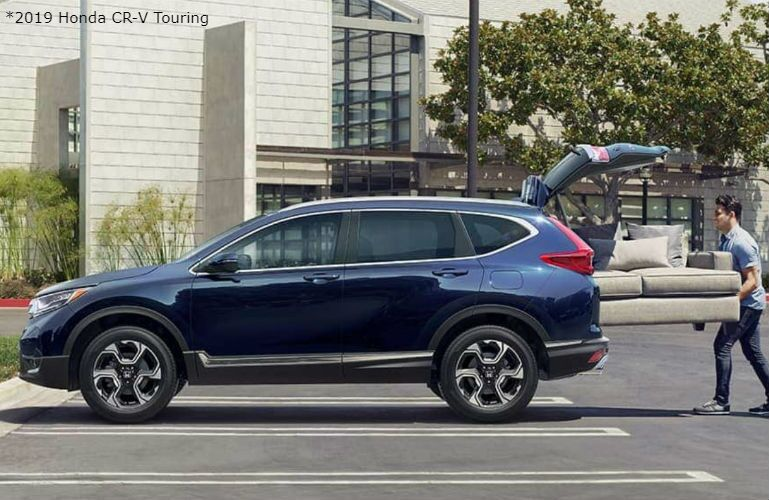 2019 Honda CR-V Touring with Hands-Free Power Liftgate and a man loading a couch