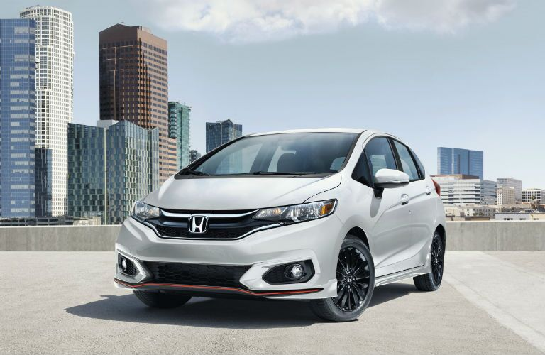 2019 Honda Fit Sport parked on roof of parking garage with city in the background
