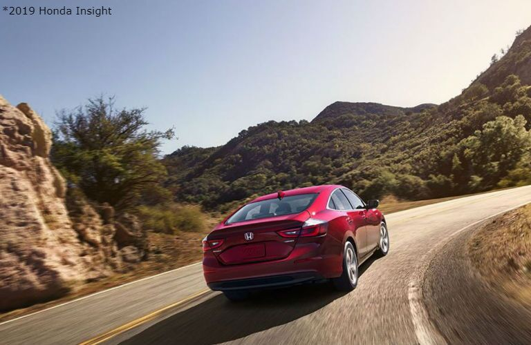 2019 Honda Insight driving up a hill