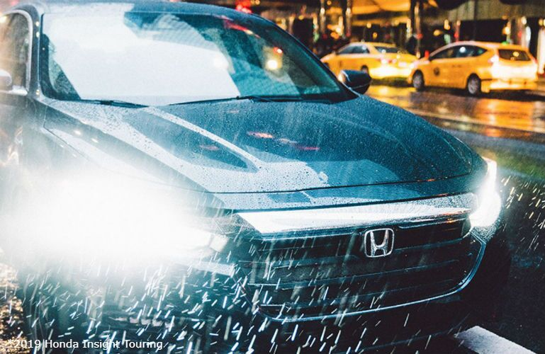 2019 Honda Insight Touring with LED headlights driving in the rain