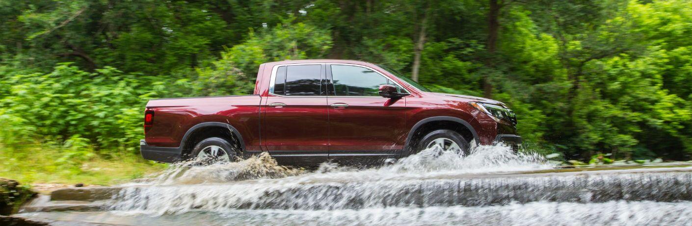 2019 Honda Ridgeline driving through a river
