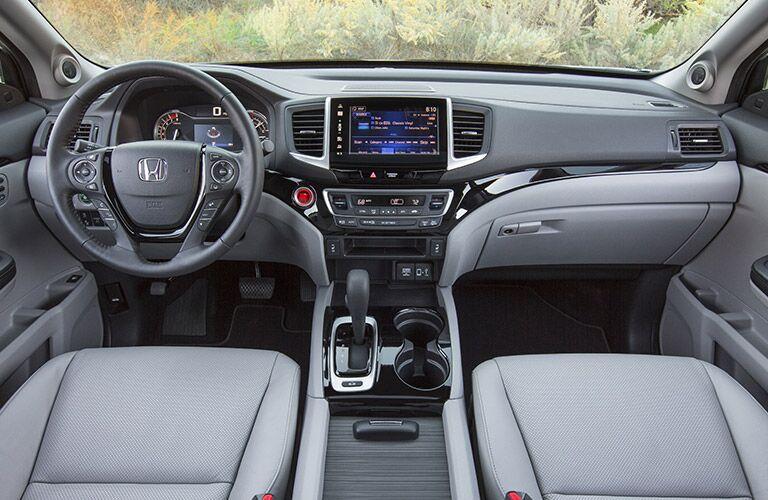 New interior 2017 Honda Ridgeline vs. 2017 Nissan Frontier