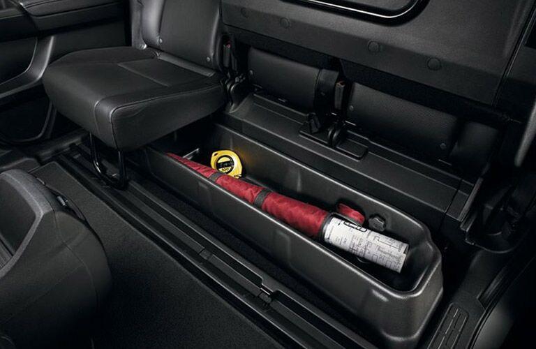 Under seat storage 2017 Honda Ridgeline vs. 2017 Nissan Frontier