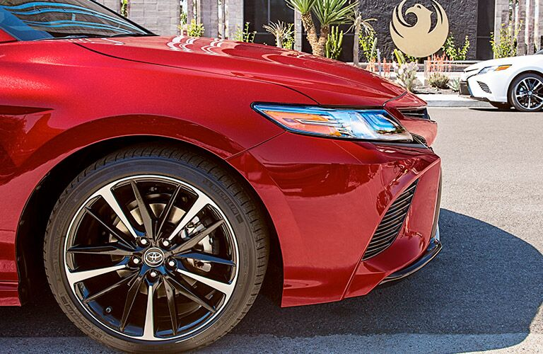 Front end of a red 2019 Toyota Camry