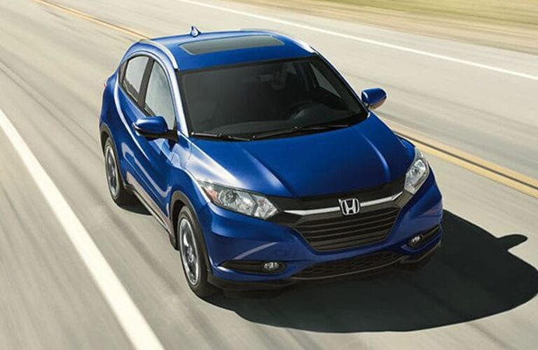 blue Honda HR-V driving
