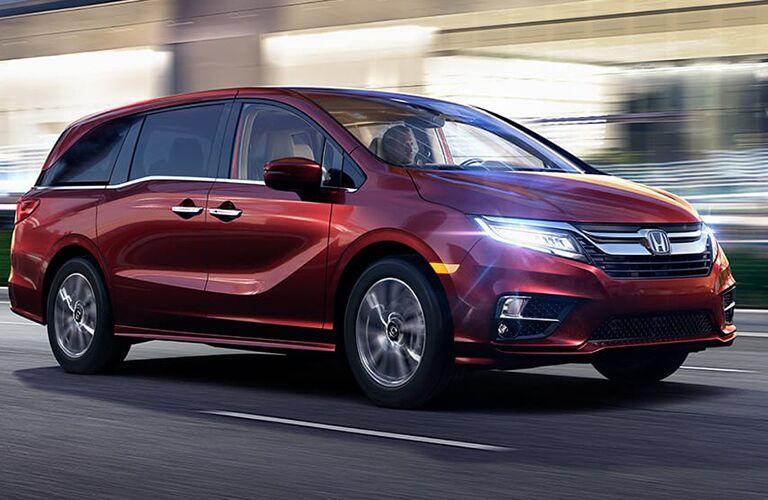 red Honda Odyssey driving