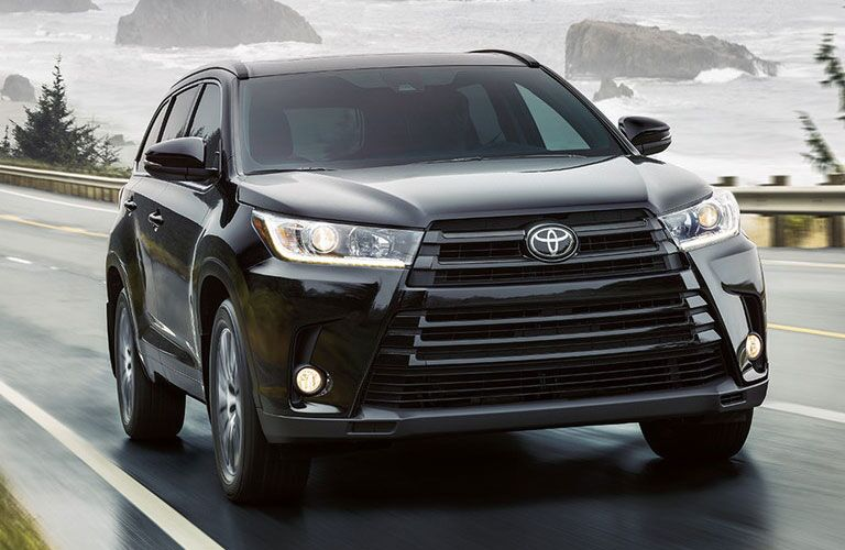 Toyota Highlander driving on a wet road