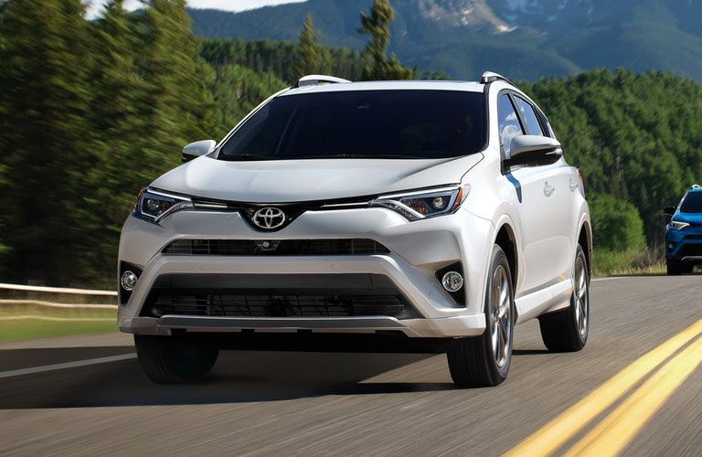 White Toyota RAV4 driving