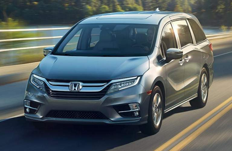 front view of 2018 Honda Odyssey driving down a road