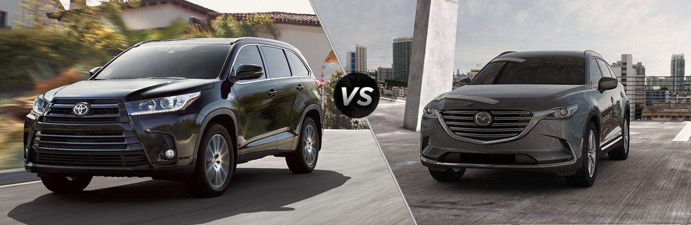 Black 2019 Toyota Highlander set against a gray 2019 Mazda CX-9