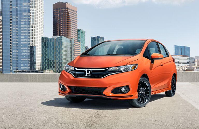 2020 Honda Fit orange exterior front driver side parked on rooftop