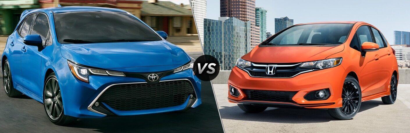 Blue 2021 Toyota Corolla Hatchback and orange 2021 Honda Fit