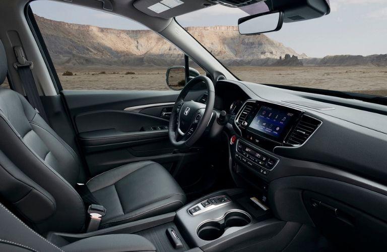 2021 Honda Ridgeline driver cockpit with desert landscape outside
