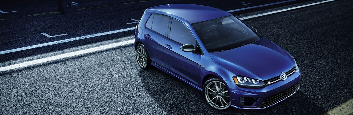 2019 Volkswagen Golf R parked off the side of the road at night