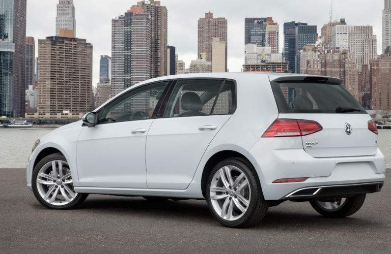 Volkswagen Golf R with city in background