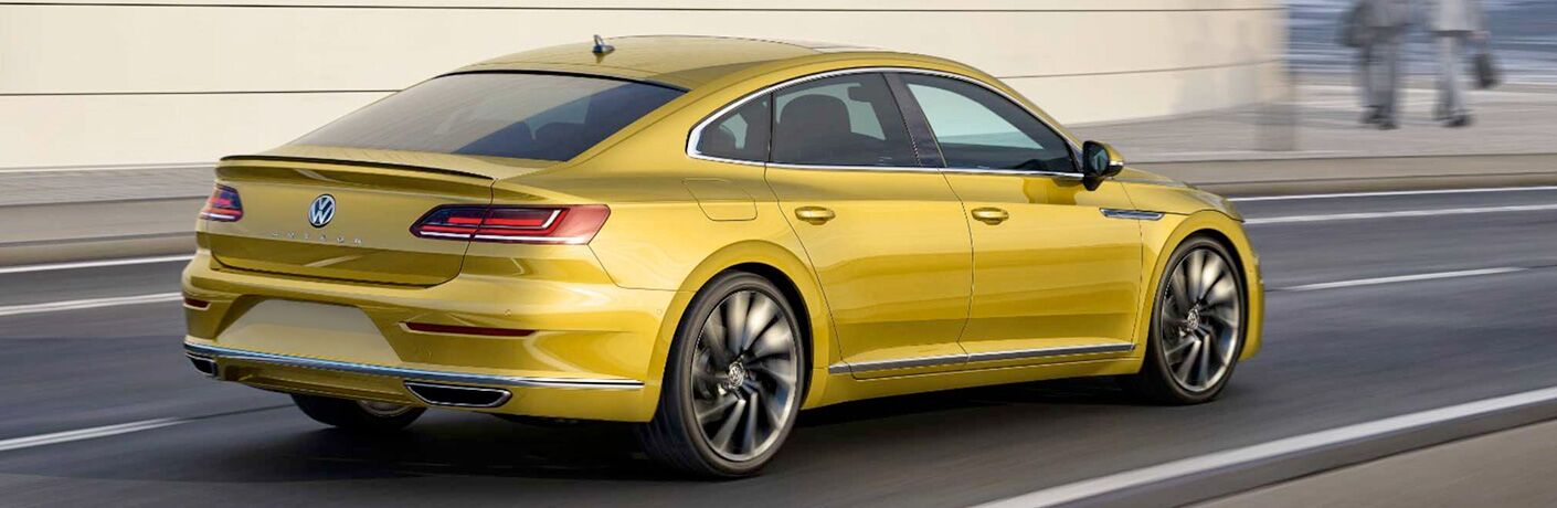 yellow 2019 Volkswagen Arteon driving down road
