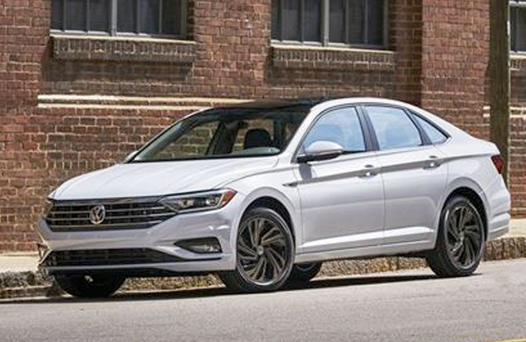 2020 Volkswagen Jetta white parked outside brick building on street