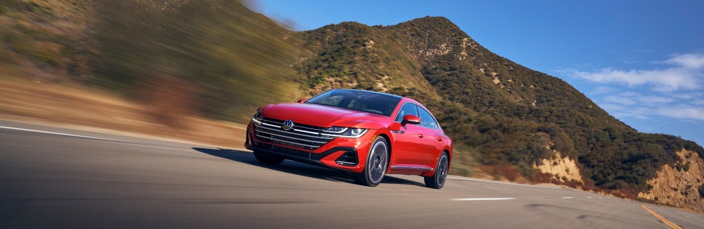 2021 Volkswagen Arteon red driving on road at high speed