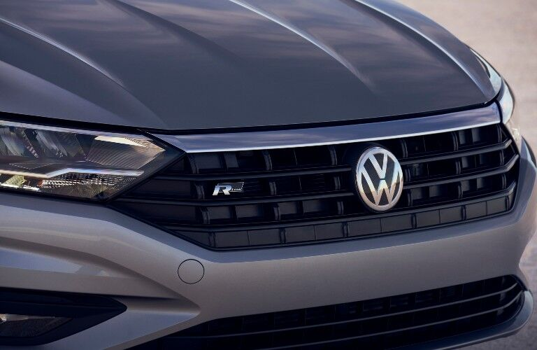 2021 Volkswagen Jetta gray close up on logo and front grille