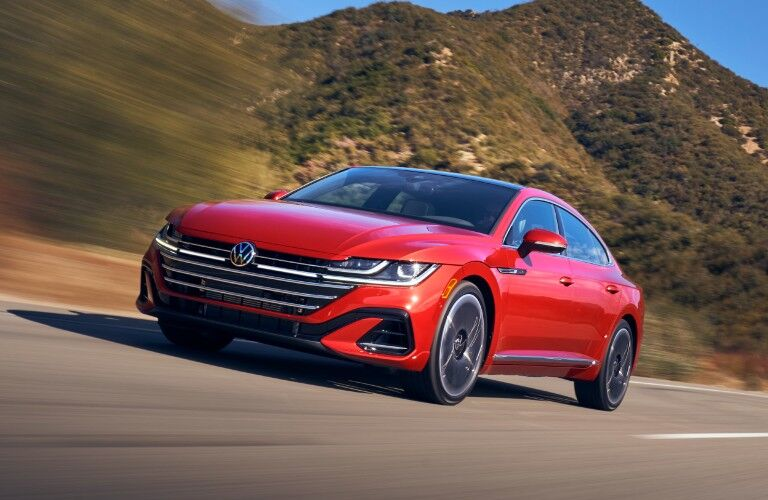 2021 Volkswagen red driving on mountain road at high speed