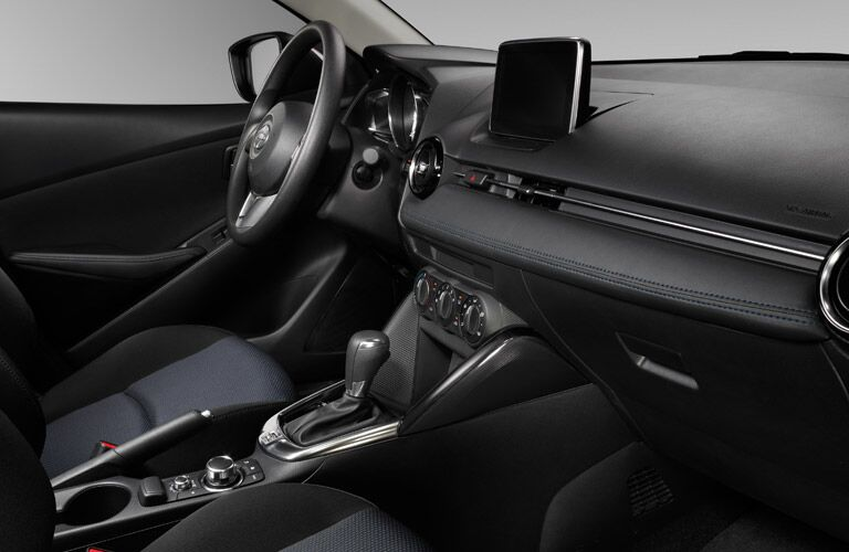 2016 Scion iA interior front driver's seat and infotainment system