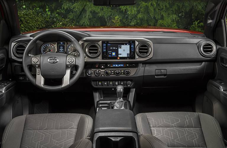 2016 Toyota Tacoma interior front seats dashboard and steering wheel