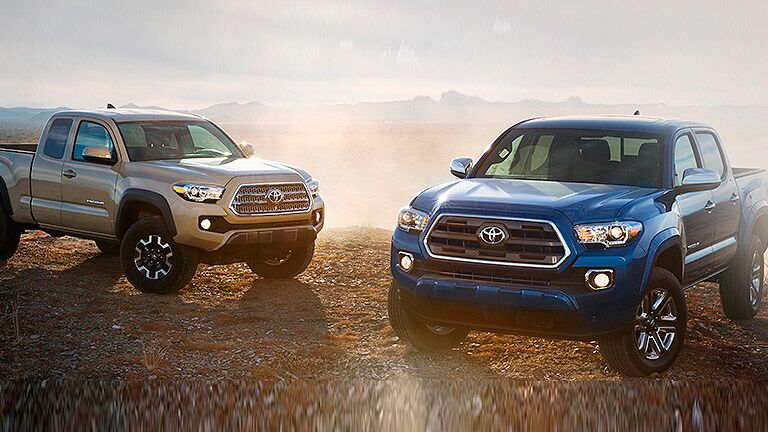 2016 toyota tacoma exterior front two models blue and tan
