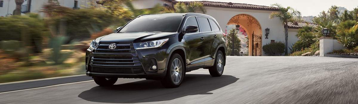 2018 Toyota Highlander Driving down the road.