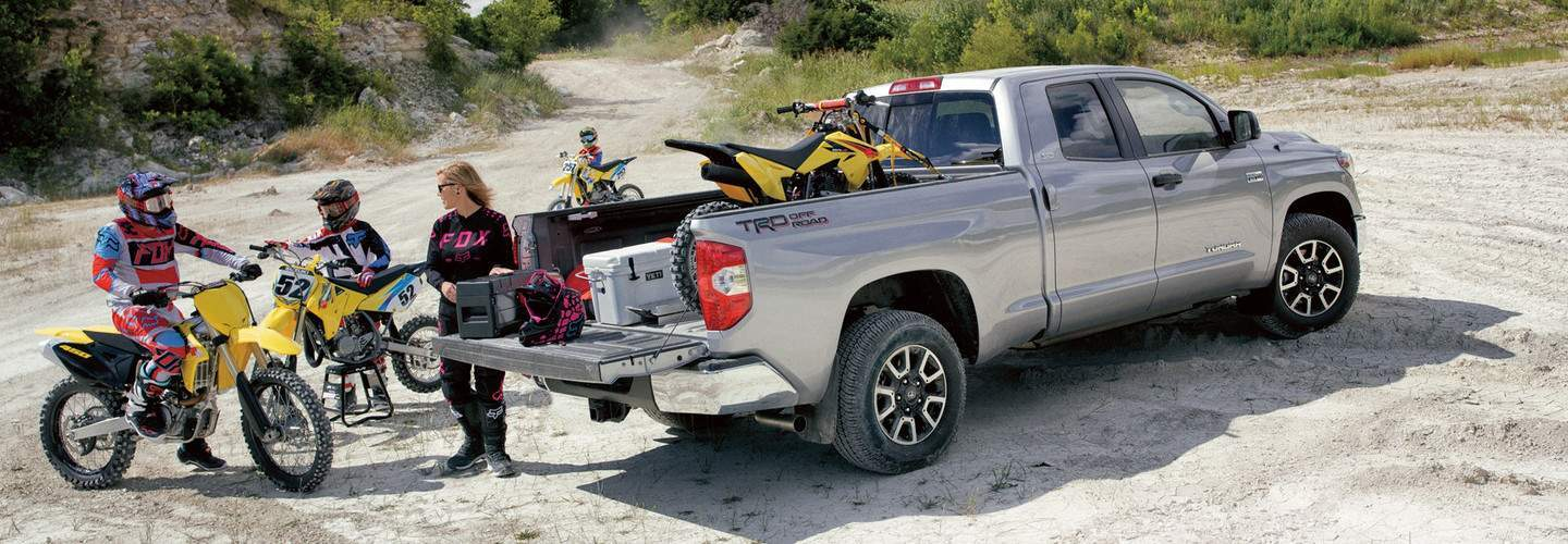 A family packing up their motocross bikes into their 2018 Toyota Tundra