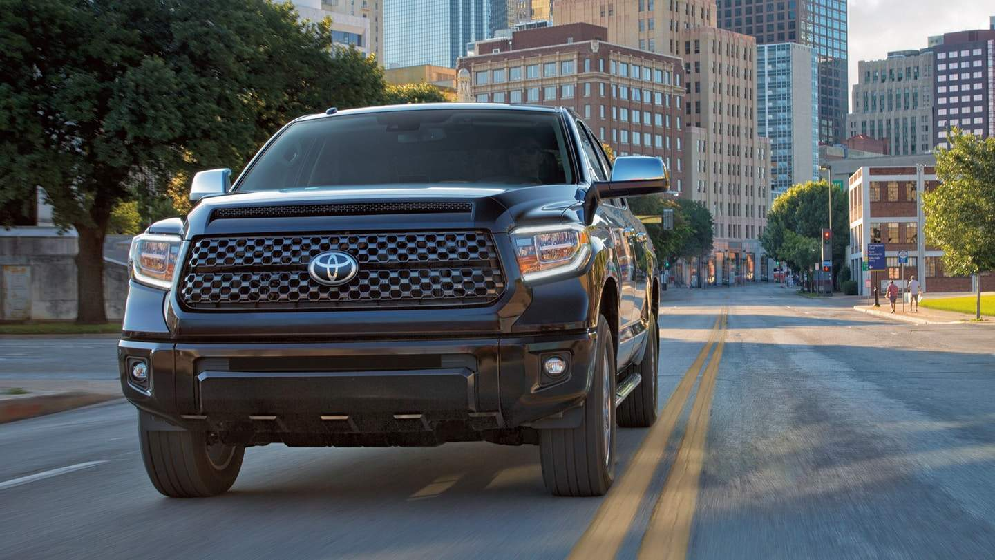 A 2018 Toyota Tundra driving out of the city
